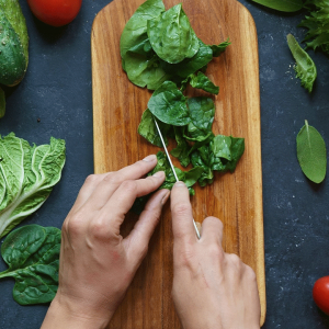 Chopping vegetables on a wooden board