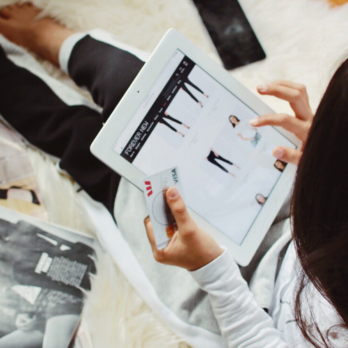Woman online shopping with tablet and credit card